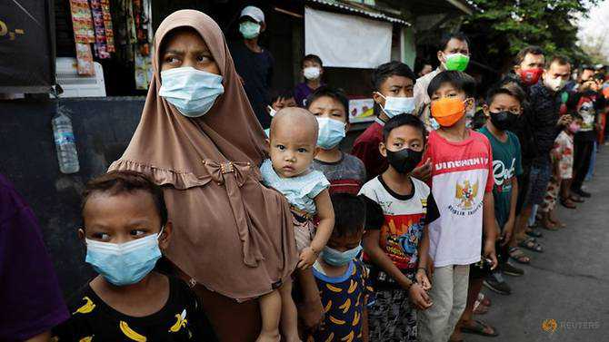 Indonesia considers extending restrictions on movement as COVID-19 cases climb