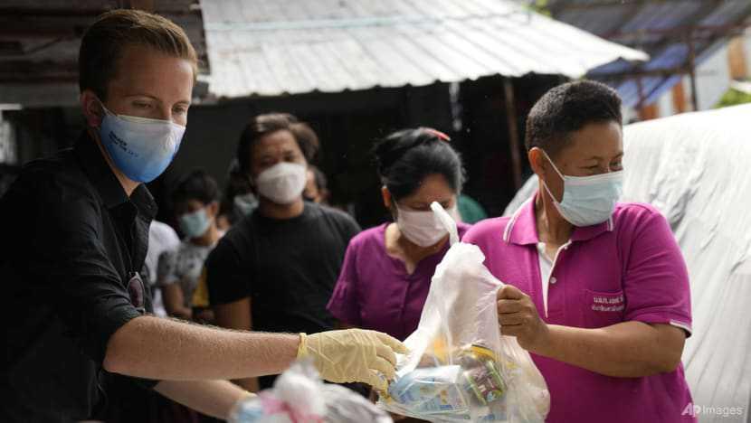 Volunteer groups help poorest survive Thailand's worst COVID-19 surge